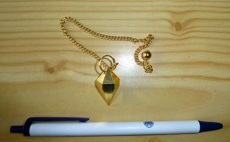 Pendant made of golden brass