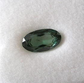 Spinel synthetic facetted 13 mm, olive-green