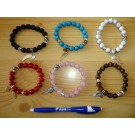 Wrist band with howlite, 10 mm spheres with metal applications 1 piece